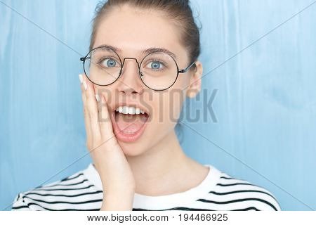 I Can't Believe This! Amazed Young European Female Wearing Nerdy Round Glasses And Striped T-shirt H