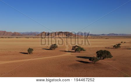Road At African Savanna Landscape. View From Elim Dune, Sossusvlei. Namibia, South Of Africa.