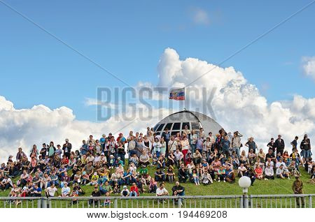 Festival of military history of Russia of XX century . Togliatti, July 7, 2017. Lot of spectators sitting on the hill.
