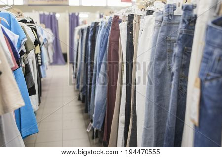Men's jeans and t-shirts on the store shelves