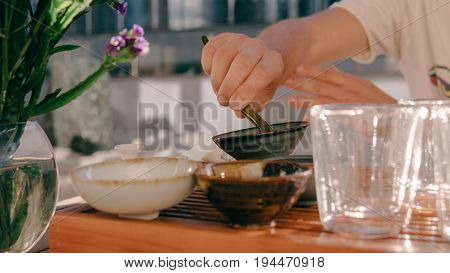 Tea Ceremony On A Shepherd With Buddha Figures Close-up. Conducting A Traditional Tea Ceremony With