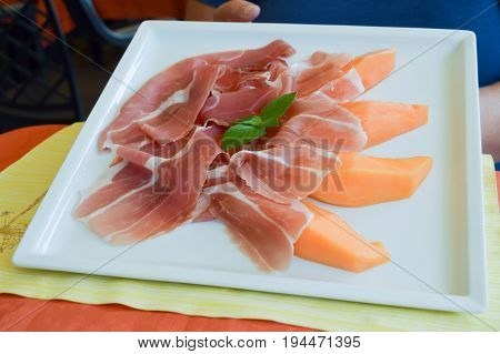 Plate of melon and Parma ham served in Italy