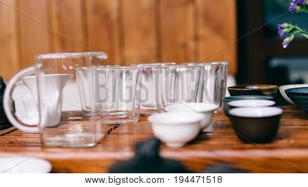 Glass Pialas At The Tea Ceremony Close-up. Transparent Bowls For Drinking Chinese Large-leaf Tea. Te