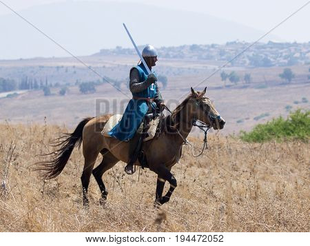 Tiberias Israel July 01 2017 : Participants in the reconstruction of Horns of Hattin battle in 1187 participate in the battle rides on the battlefield near TIberias Israel