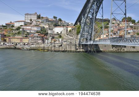 PORTO, PORTUGAL - AUGUST 7, 2015: View of the city of Porto along the river Douro and the bridge Dom Luis from Gaia Porto Portugal
