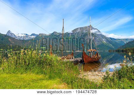 Old viking boat replica in a norwegian landscape Norway.