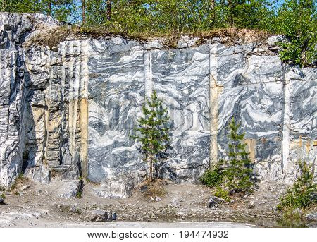 Marble quarry marble rocks in the wild in the Republic of Karelia Russia. The natural stone. Ancient Marble quarry marble rocks in the wild. Slices of marble mountain. Tourism and travel.
