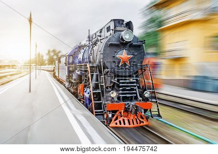 Vintage Black Steam Locomotive Train Rush Railway. The Concept Of Tourism Is A Retro Journey By Trai