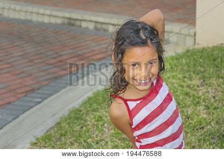 GUAYAQUIL, ECUADOR, AUGUST - 2018 - High angle shot of ecuadorian kid girl smiling at camera