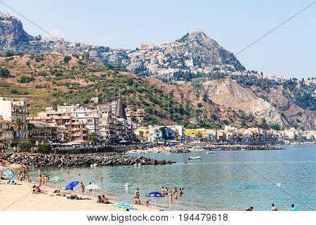 People On Urban Beach In Giardini Naxos Town