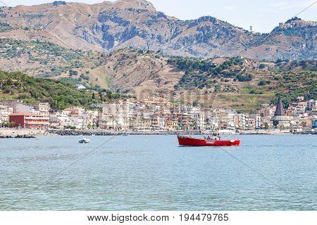 Boats In Sea Near Waterfront Of Giardini Naxos