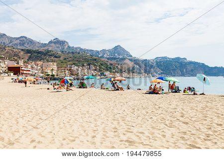 Acationers On Urban Beach In Giardini Naxos Town