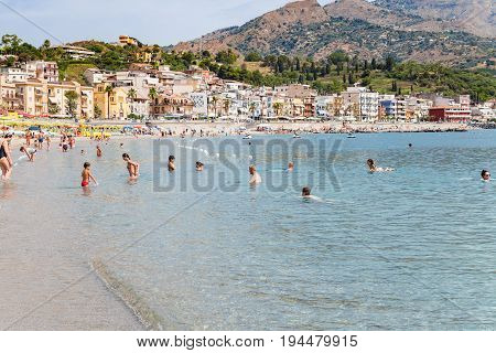 Vacationers On Beach Of Giardini Naxos City