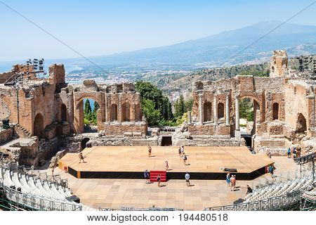 Teatro Greco And View Of Etna Mount In Taormina