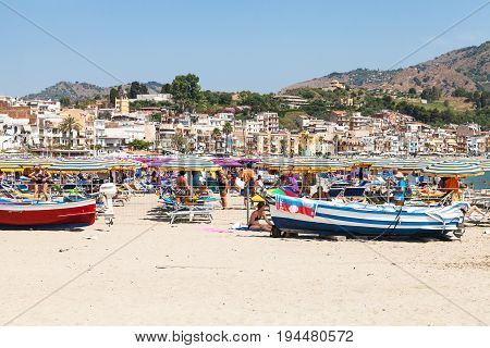 Tourists And Boats On Beach In Giardini-naxos City