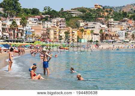 Tourists On Urban Beach In Giardini Naxos City