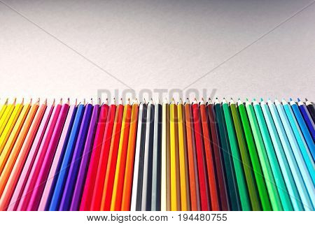 Row of multi colored pencils