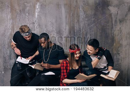 Students doing their homework together. Ghetto scientists are engaged in science. Illegal immigran's education, self-development, distance education, social problems concept