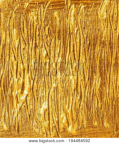 Gold brush strokes acrylic background. Golden textured background