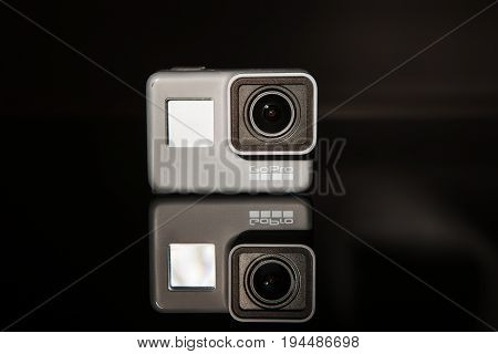 Kharkov, Ukraine - April 13, 2017: GoPro HERO 5 digital action camera on black background . Compact gadget waterproof , support 4k video, voice controls and is often used in extreme photography