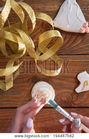 Cupcake decorated with powder, baking present. Colorful food, homemade cookies, small business. Decorating beautiful colors, cooking concept