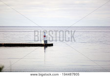A view of Lake Michigan, the breakwater, and the Pierhead Lighthouse, as seen from Sunset Park in Petoskey, Michigan.