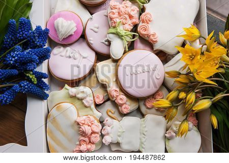Many colorful wedding gingerbread with flowers on table top view. Wedding present, sweet dessert, beautiful bakery, baking concept