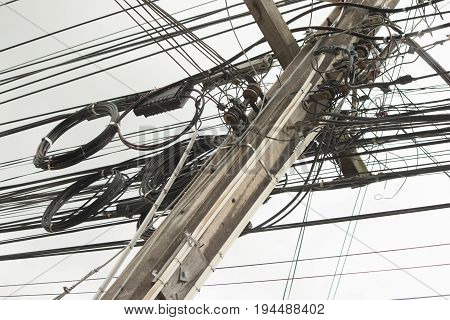 Electric pole with power cable and junction on outdoor.