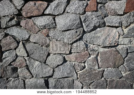 Rubble gray and brown stone wall rubblework.