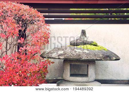 Japan, Takayama, Stone Lantern and bush in Autumn colors
