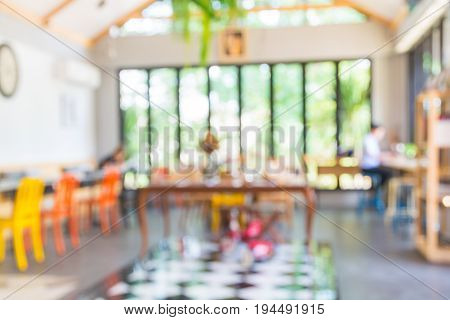 Abstract Blur Background Of People Woking In Cafeteria Or Coffeeshop Co-working Space As Modern Free