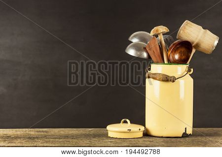 Kitchen tools on a wooden table. Cook's tools. Traditional equipment of rural cuisine