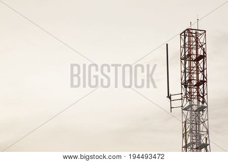 Radio tower with sky on evening time.