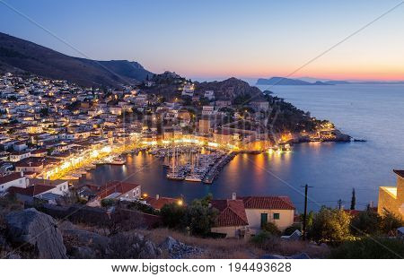 A View From Above Of Hydra Island, Greece. City Of Hydra And Yacht Marina At Sunset