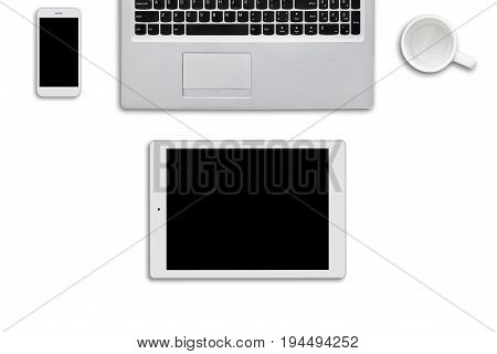 Modern Gadgets Lying On White Surface. Laptop Computer, Tablet And Smart Phone And White Empty Cup O