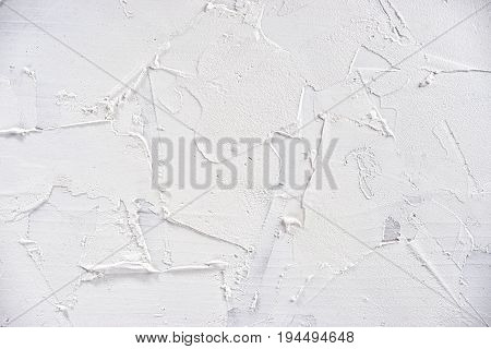 White abstract texture of surface covered with putty