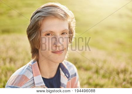 Close Up Portrait Of Attractive Teenager With Dark Eyes, Pure Skin And Trendy Hairstyle Wearing Shir