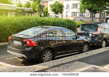 STRASBOURG FRANCE - MAY 30 2017: Black Volvo S60 d5 awd limousine car parked in the city. The Volvo S60 is a compact executive car manufactured and marketed by Volvo since 2000 and is now in its second generation.