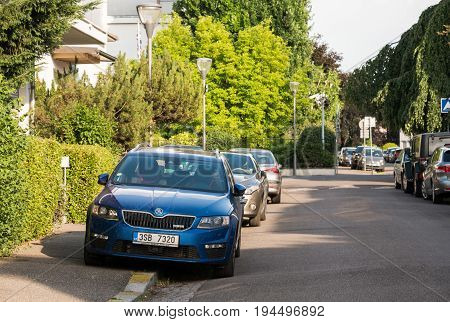 PARIS FRANCE - MAY 29 2017: Sport racing Skoda V RS parked on the French street with French architecture in the background and pedestrian on the sidewalk
