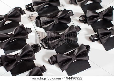 Black bowtie. Black bowtie on a white background. Dress code for a party. men's accessories.