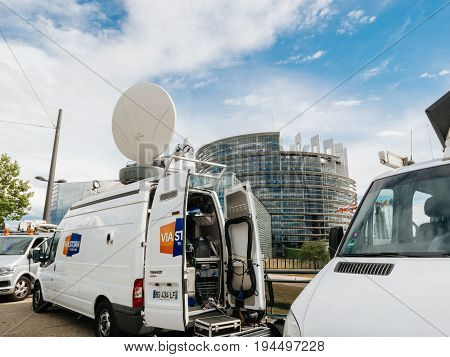 STRASBOURG FRANCE - JUN 30 2017: TV Media Television Trucks with multiple Satellite parabolic antennas and fiber optic cables preparing to report live the official European Ceremony of Honour for Dr. Helmut Kohl at European Parliament
