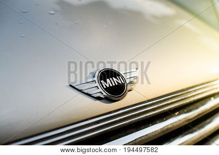 STRASBOURG FRANCE - may 30 2017: Silver Mini Cooper car parked in the city with prominent MINI logotype insignia