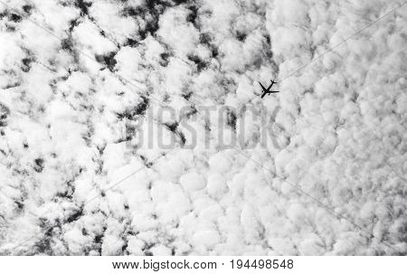 Travel background with airplane silhouette in the sky