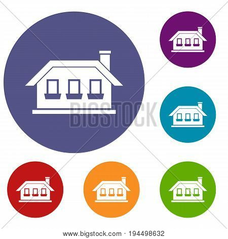 One-storey house with three windows icons set in flat circle reb, blue and green color for web