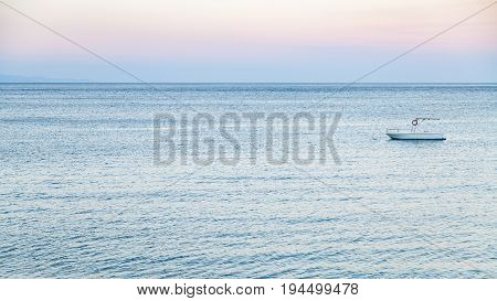 View Of Boat In Ionian Sea In Summer Twilight