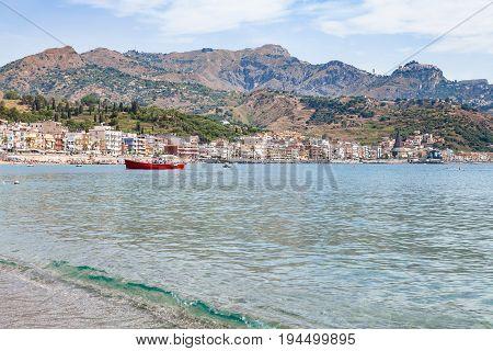 Boat In Sea Near Waterfront Of Giardini Naxos