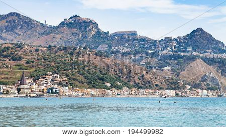 Giardini Naxos Town And Taormina City On Cape