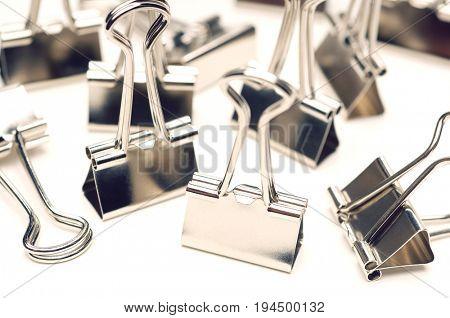 Binder clip on white background