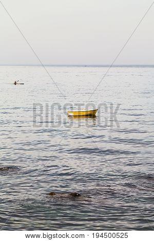 Yellow Boat Near Waterfront In Giardini Naxos