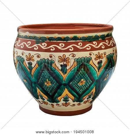 Colorful covered with glaze ceramic handmade pot. Painting in the technique Kosovo ceramics - it really authentic Ukrainian technique of painting on clay. Isolated on a white background